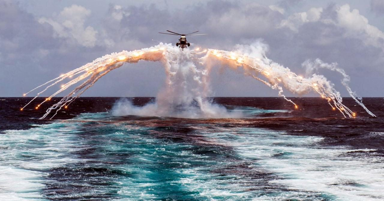 A Canadian Navy CH-124 Sea King helicopter deploying flares over the Indian Ocean, 2014