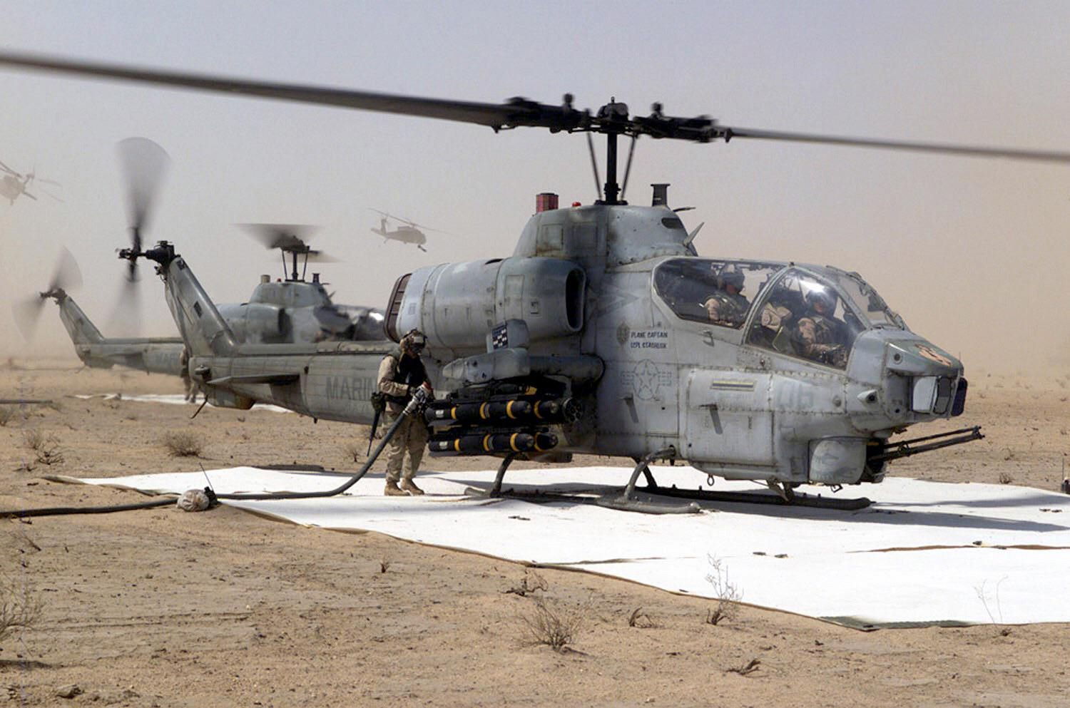 AH-1W Cobra helicopter gunship, from the 3rd Marine Aircraft Wing (MAW) at a forward aircraft refueling point on Jalibah Air Bas