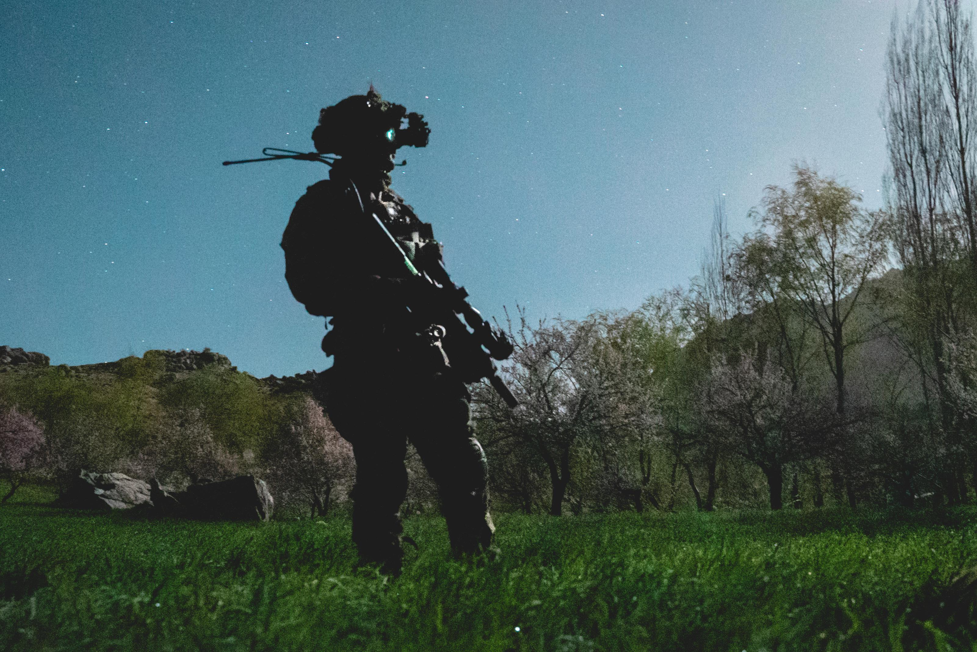 A United States Army Ranger from the 75th Ranger Regiment stands in a field during a combat operation as part of Operation Resol